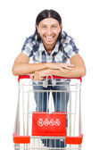 Man shopping with supermarket basket cart isolated on white — Stock Photo