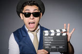 Funny man with movie clapper — Stock Photo
