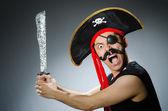 Funny pirate in the dark studio — Stock Photo