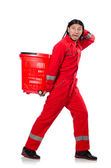 Man in red coveralls with shopping supermarket cart trolley — Photo