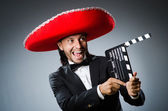 Mexican man with movie board clapboard — Stock Photo