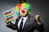 Funny clown businessman with abacus — Stock Photo