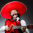 Mexican man with guitar isolated on white — Stock Photo #51327477