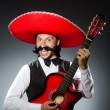 Mexican man with guitar isolated on white — Stock Photo #51327487