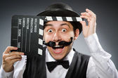Funny man with movie clapper board  — Stock Photo