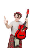 Scotsman playing guitar isolated on white — Stock Photo