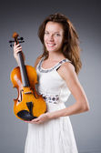 Woman artist with violin in music concept — Stock Photo