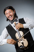 Funny fiddle violin player in musical concept — Стоковое фото