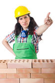 Woman builder isolated on the white — Stock Photo