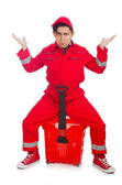 Man in red coveralls with shopping supermarket cart trolley — Stockfoto