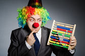 Funny clown businessman with abacus — Стоковое фото