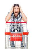 Man shopping with supermarket basket cart isolated on white — Стоковое фото