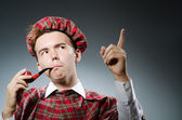 Funny scotsman smoking pipe tobacco — Foto de Stock