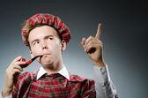 Funny scotsman smoking pipe tobacco — Стоковое фото