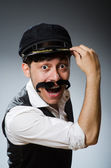 Funny taxi driver wearing peaked cap — Stock Photo