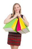 Woman after shopping spree on white — Стоковое фото