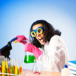 Chemist in the lab experimenting with solutions — Stock Photo #6327423