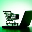 Silhoette of shopping cart and laptop — Stock Photo #6606990