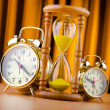 Time concept with alarm clock and hourglass — Stock Photo #7968909