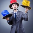 Magician in the business suit — Stock Photo #9099293