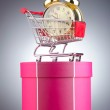 Buying time concept with clock and shopping cart — Stock Photo #9471289