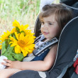 Small child sits in an automobile chair — Stock Photo