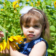 Girl in dark blue and sunflowers — Stock Photo