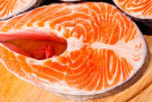 Raw salmon steaks are zoomed on white — Stock Photo