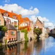 Beautiful view of a canal and , bridge, red roofs in Bruges, Bel - Stock Photo