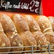 Bread and rolls on a shop show-window — Stock Photo