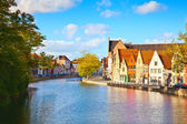 Colourful old houses reflected on water at Brugge - Belgium — Stock Photo