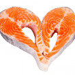 A heart made of two raw salmon steaks, isolated on the white bac - Stock Photo