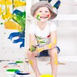 Girl in a cap with paints — Stock Photo #23385650