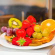 Waffles with fruits and berries on a plate — Stock Photo