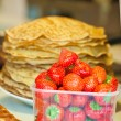 Ripe strawberry and pancakes on the counter — Stock Photo