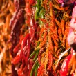 Bunches of different peppers on the market — Stock Photo