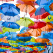 Stock Photo: Street decorated with colored umbrellas.