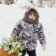 Little girl in a down scarf, a fur coat and valenoks bears a bi — Foto Stock