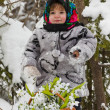 Little girl in a winter wood with the big basket of snowdrops — Stockfoto #37401205
