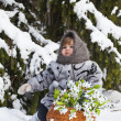 Little girl in a winter wood with the big basket — Stock Photo #37401307
