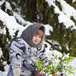 Little girl in a winter wood with the big basket of snowdrops — Stock Photo #37401335