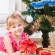 Girl with gifts near a New Year tree — Stock Photo #8384438