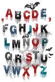 Alfabet dla halloween i latające nietoperze — Wektor stockowy