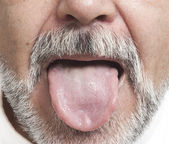 Man sticking out his tongue — Stock Photo