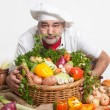 Foto Stock: Smiling attractive chef with vegetables