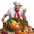 Photo: Smiling attractive chef with vegetables