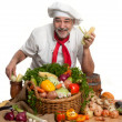 Stockfoto: Smiling attractive chef with vegetables