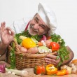Zdjęcie stockowe: Smiling attractive chef with vegetables