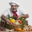 Smiling attractive chef with vegetables — 图库照片 #18966547