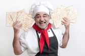 Smiling cook with matzot for passover celebration — Stock Photo